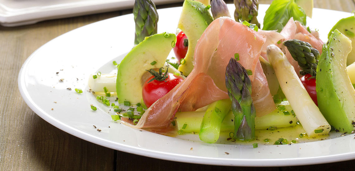 Asparagus salad with prosciutto crudo, avocado and cherry tomatoes