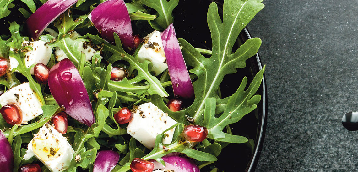 Rocket salad with feta and red onion