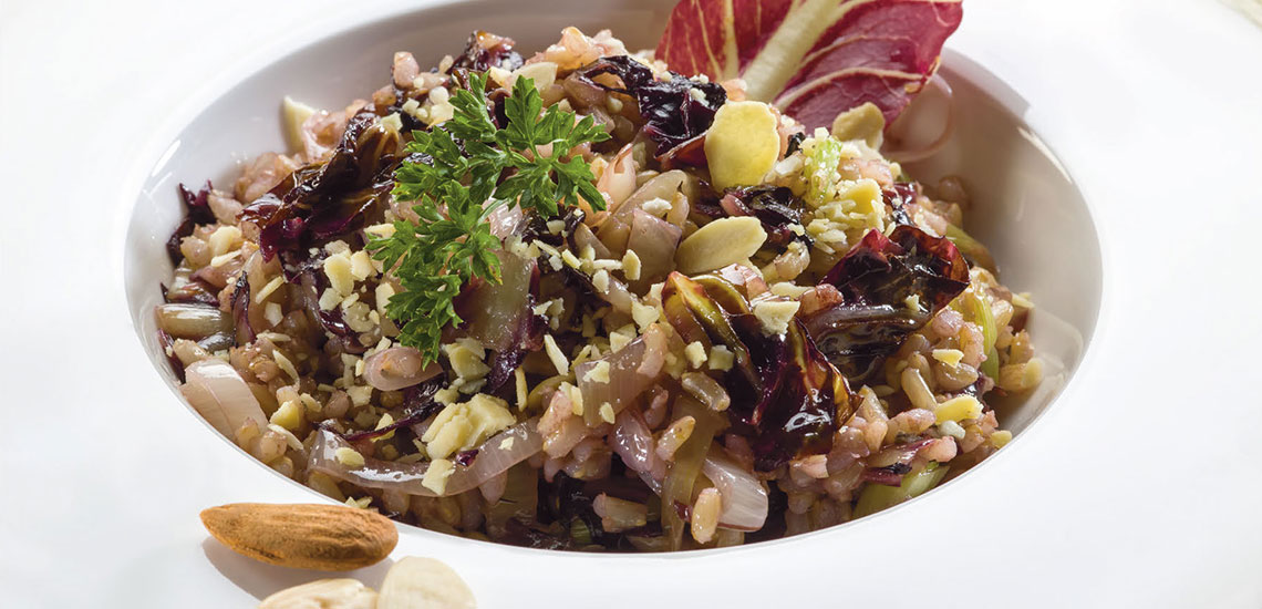 Shallot risotto with red radicchio and almonds