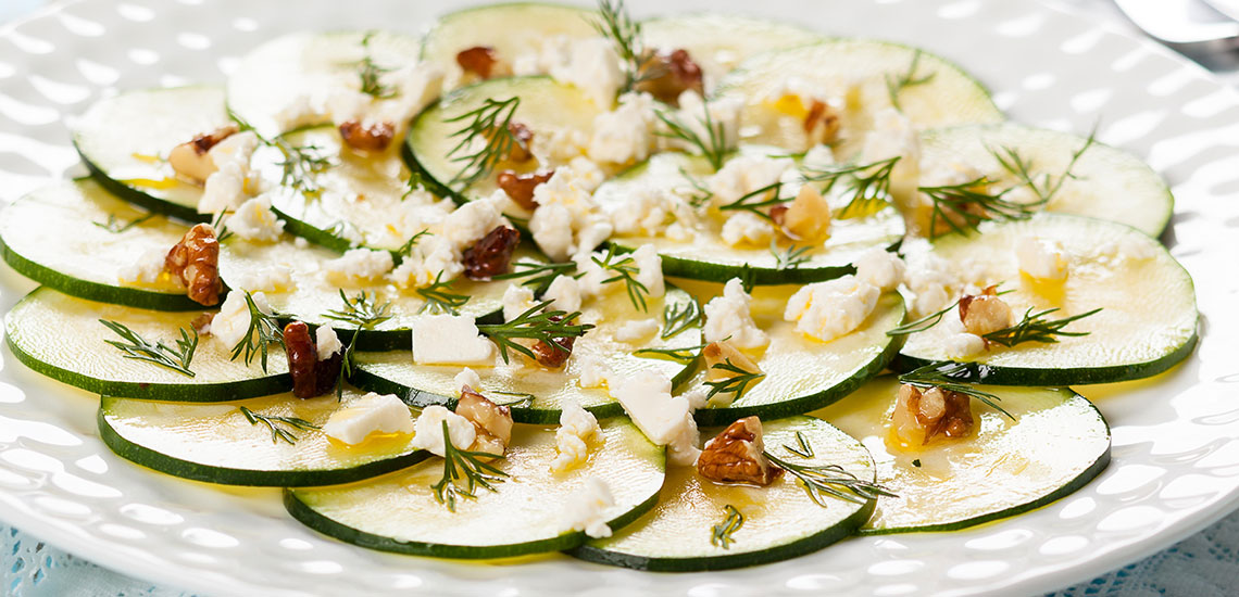 Carpaccio of round courgettes, with feta cheese and walnuts