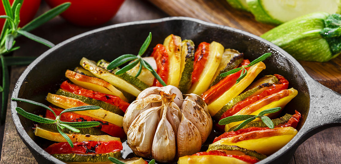 Roast potatoes with courgette and tomatoes