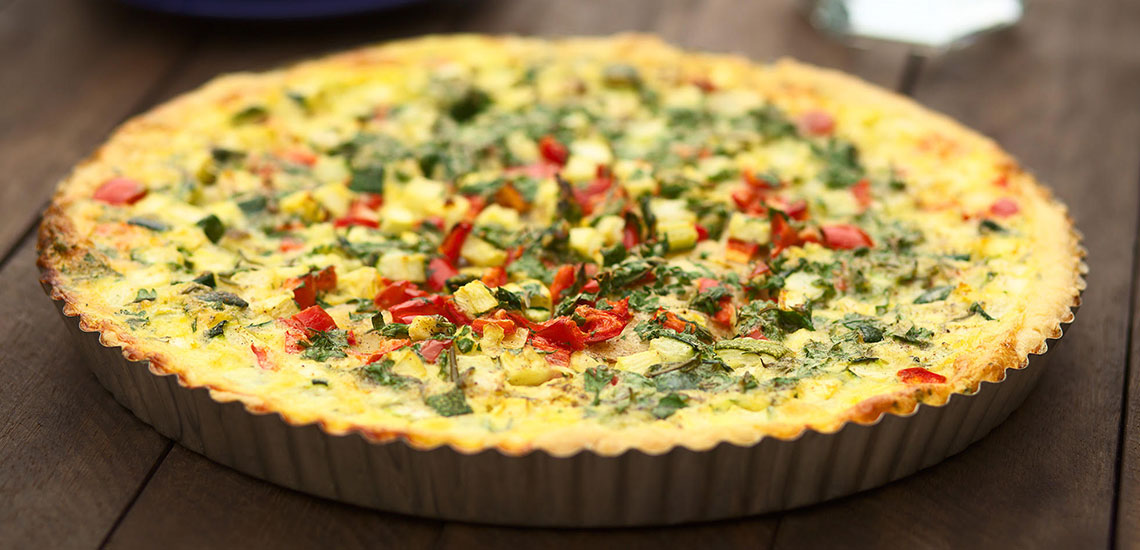 Vegetarian quiche with red peppers and courgettes