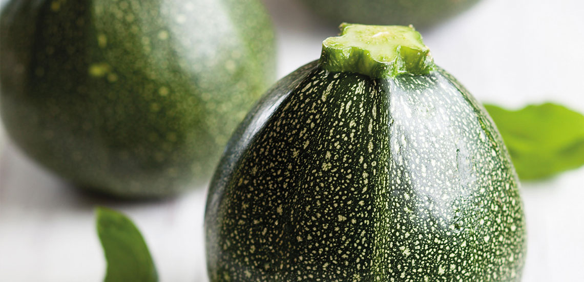 Round courgettes stuffed with cherry tomatoes, olives and capers